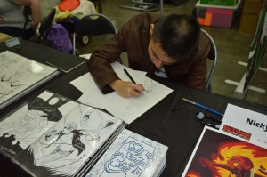 Aspiring artist Nicky Soh at work. (Anthony C. Hayes)