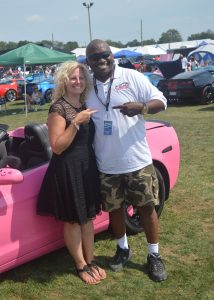Tracie Jones and Jeff Scruggs share a smile and embrace at Corvettes at Carlisle 2016. (Anthony C. Hayes)