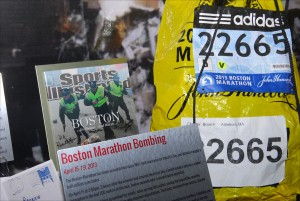A runner's bib, a Sports Illustrated magazine cover and other artifacts associated with the Boston Marathon bombing of April 15, 2013, are on display at the National Museum of Crime & Punishment in Washington DC, as part of a permanent exhibit on domestic terrorism and hate crimes. (Larry Luxner)