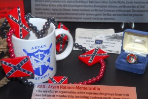 Key chains, coffee mugs, business cards and other memorabilia from the Ku Klux Klan and Aryan Nations are on display at the National Museum of Crime & Punishment in Washington DC, as part of a permanent exhibit on domestic terrorism and hate crimes. (Larry Luxner)