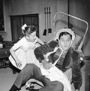 Danny Thomas and his television daughter, Angela Cartwright, play house in this publicity photo from the television program, Make Room for Daddy. (Wikimedia)