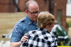 May 28, 2018, Ellicott City, Md. - Howard County Major Jones consoles a business owner during the aftermath of the May 27th storm that produced over 8 inches of rainfall in a very short period of time across Howard County. The downpour caused massive flooding through Ellicott City devastating Main Street homes and business. This flood is reminiscent of the 2016 flood from which the community still haven't fully recovered. (Mike Jordan / BPE)