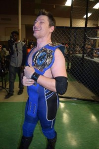 "Wes Mercer laughs his way out of the arena with his fourth EWA Cruiserweight Championship. (David ""Ace"" Livingston)"
