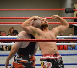 Flexing his muscles in a losing cause, Aplollo Cruz prepares to flip Bill Ward. (Anthony C. Hayes)
