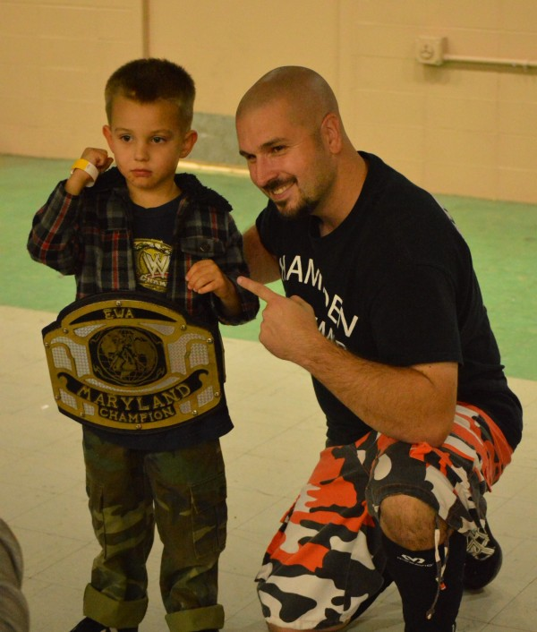"Crowd favorite Bill ""Hampden Hammer"" Ward lends his belt to a young fan. (Anthony C. Hayes)"