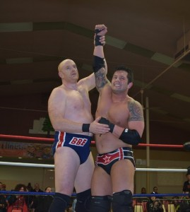 "Ring of Honor veteran ""Brutal"" Bob Evans lifts the arm of a victorious Joey Badami. (David ""Ace"" Livingston)"