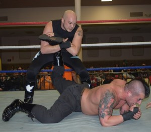 "#PatAnthony works the injured leg of Joey Badami. (David ""Ace"" Livingston)"