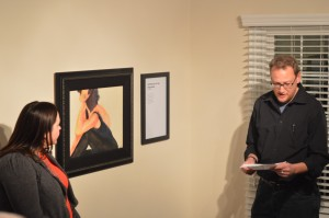 Artist listens as writer Gregg Wilhelm reads his poem based on their collaboration. (Anthony C. Hayes)
