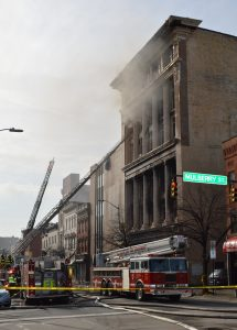 In Market Center, Baltimore City firefighters on the scene of the smoldering Gomprecht and Benesch Building. (Anthony C. Hayes)