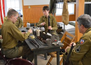 Reenactors learn how to clean their weapons during the stand down at the 2018 Battle of the Bulge Commemoration at Fort Indiantown Gap, PA. (Anthony C. Hayes)