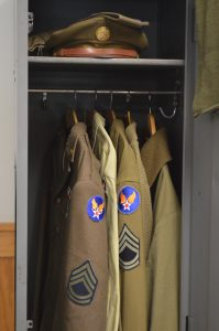 WWII-styled uniformes in a locker at Ft. Indiantown Gap. The Garrison will now also require that reenactors in leadership capacities adhere to Army standards of certification for non-commissioned officers and officers.  (Anthony C. Hayes)