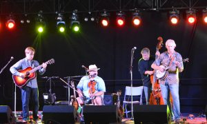The 2014 International Bluegrass Music Association's Instrumental Group of the Year, Frank Solivan & Dirty Kitchen, perform on the Music Hall stage. Dirty Kitchen is Chris Luquette – guitar, Solivan – mandolin/fiddle, Jeremy Middleton- bass, and Mike Munford- banjo.