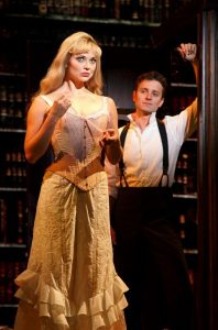 Kristen Beth Williams as Sibella toys with Kevin Massey as the murderous Monty Navarro in the touring production of A Gentleman's Guide to Love and Murder.