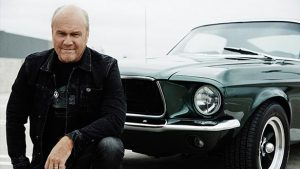 Greg Laurie author of Steve McQueen: The Salvation of an American Icon, with his 1968 Mustang.