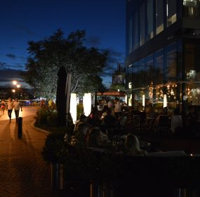 Loch Bar diners make merry on a warm summer evening in Harbor East in Baltimore, MD. (Anthony C. Hayes)