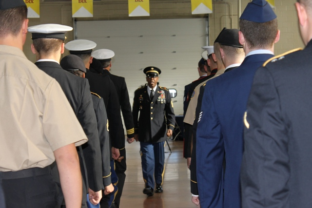 Fort Meade Garrison Command Sgt. Rodwell Forbes rehearses an Honor Salute performed by dozens of uniformed active duty military personnel, veterans, midshipmen and NJROTC students. (Elyzabeth Marcussen)