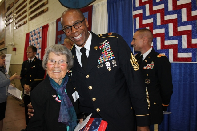 Lucy Libby, of Annapolis, gets a hug from Fort G. George Meade Garrison Command Sgt. Maj. Rodwell Forbes. Libby served in World War II in Saipan as a nurse. (Elyzabeth Marcussen)