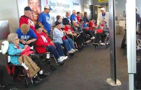 Honor Flight veterans from New York smile with appreciation for the warm reception they received at BWI. (Lisa Salkov)