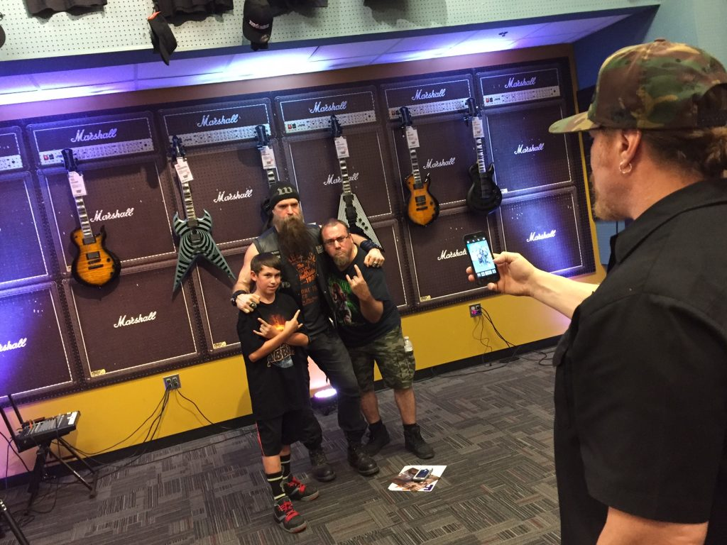 Zakk Wylde poses with fans for a photo at Guitar Center in Rockville, Md. (Justin Duckham)