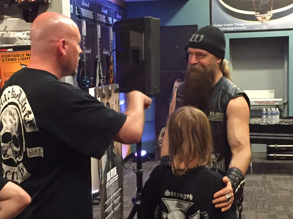 Guitarist Zakk Wylde talks with fans at Guitar Center in Rockville, Md. (Justin Duckham)