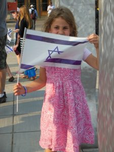 "A young girl shows her pride during a rally for Isreal in Baltimore. JMORE: ""We're covering the entire spectrum of the Jewish population, and they will see themselves in our pages,"" (Anthony C. Hayes)"