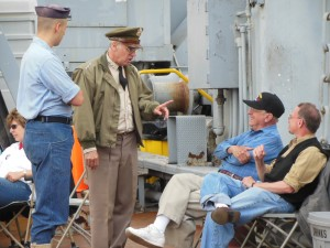 Reenactor Jim Callear as Gen. Omar Bradley discusses the Korean War with veteran Roy Wagner and his son Jim.  (Anthony C. Hayes)