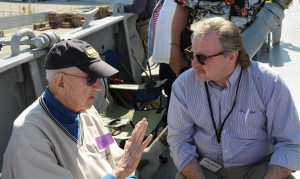 Veteran William Fitzpatrick shares his story with feature writer Anthony C. Hayes. (Bev Geiger)