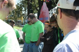 Pausing for prayer with a group of volunteers.