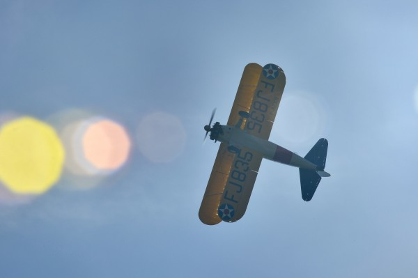 PARIS Ð A World War I-era Stearman PT-17 biplane flies over the Lafayette Escadrille Memorial in Marnes-la-Coquette, France, April 20, 2016, during a ceremony honoring the 268 Americans who joined the French air force before the U.S. officially engaged in World War I. In addition to the Stearman, four U.S. Air Force fifth generation F-22 Raptor fighters, a B-52 Stratofortress bomber, and four French air force Mirage 2000Ns performed flyovers during the ceremony commemorating the 100th anniversary of the Layfette EscadrilleÕs formation. Men of the Lafayette Escadrille and Lafayette Flying Crops were critical to the formation of the U.S. Air Force. (U.S. Air Force Photo by Tech. Sgt. Joshua DeMotts)