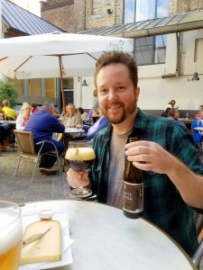 Author and filmmaker Leonard Kinsey enjoying the tastes of Bruges, Belgium.
