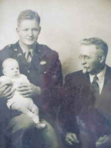 Edward A. Peters III on his father's lap as his grandfather looks on. (Courtesy)