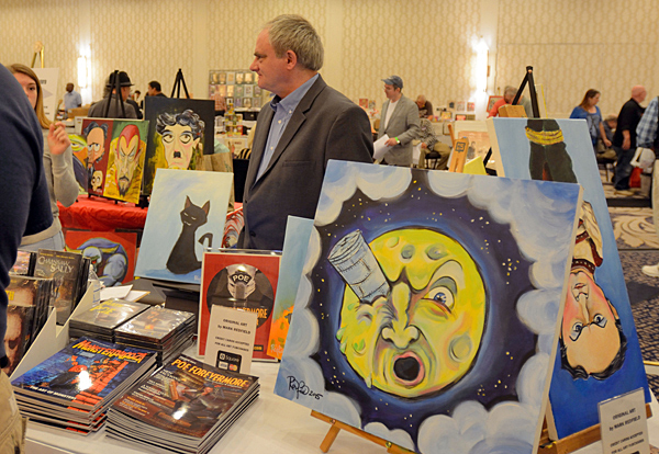 Actor and artist Mark Redfield with his paintings. (Cheryl Fair)