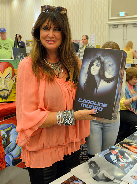 Cult queen Caroline Munro with a brand new boxed action figure. (Cheryl Fair)