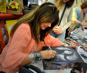 Caroline Munro signs a collectors prize Munro action figure box. (Cheryl Fair)