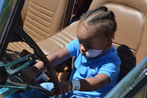 A little boy behind the wheel of a 1967 Corvette. On Saturday, July 7, 2018, the Mason-Dixon Chapter of the National Corvette Restorers Society (NCRS) paid its annual visit to the Mt. Washington Pediatric Hospital in Baltimore (credit Anthony C. Hayes).