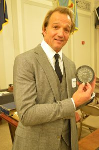 Francis Warrington Gillet III holds the altimeter from his grandfather's Sopwith Dolphin. (Anthony C. Hayes)