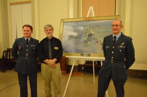 Maryland Over Flanders artist Michael O'Neal (c) is flanked by RAF Wing Commanders Nev Clayton and Clive Mitchell. (Anthony C. Hayes)