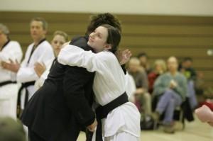 Student Ciavolo get a hug from her mentor Master Joe. (Courtesy Emily Ciavolo)