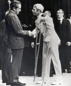 John McCain (pictured here being greeted upon his return by President Nixon) spent five years as a POW.