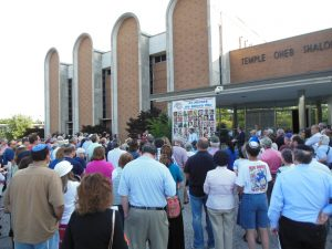 "A vigil at Temple Oheb Shalom in Baltimore to remember those killed in rocket attacks. ""The close-knit local Jewish community craves more substance in coverage and that JMORE could succeed if it fulfills that demand."" (Anthony C. Hayes)"