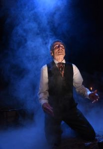 In A Christmas Carol at Olney Theatre, Paul Morrella channels Scrooge in tortured moment from one his ghostly encounters. (Stan Barouh)
