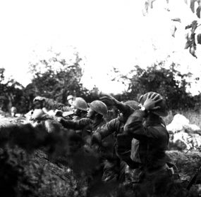 American soldiers on the Piave front hurling a hand grenades during World War I.