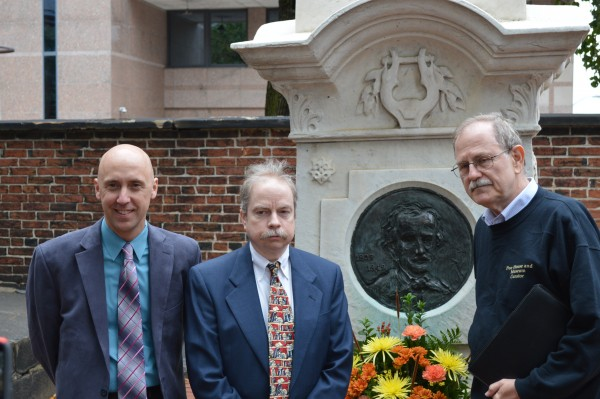 Scott Chancellor, Jeffrey Savoy and Jeff Jerome at the grave of Edgar Allan Poe. (Anthony C. Hayes)