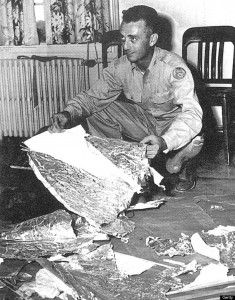 Major Jesse Marcel hold some of the debris recovered from the 1947 incident near Roswell, New Mexico.