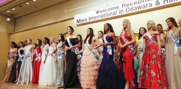 Shanel James(pictured in a purple gown) at a welcome reception for Miss US International.