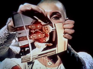 Sinead O'Connor rips up a photo of Pope John Paul II on live TV, shocking audiences and producers alike