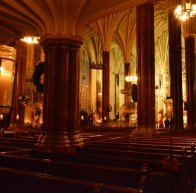 The candlelit sanctuary of St. Alphonsus Church in Baltimore, Maryland. (Anthony C. Hayes)