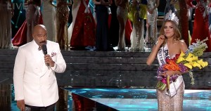 Host Steve Harvey walks to the front of the stage to announce he's made a mistake. Gutierrez is clearly confused.