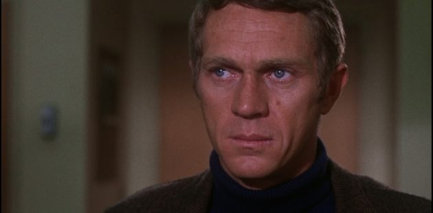 Actor Steve McQueen in a screenshot from the movie Bullitt.