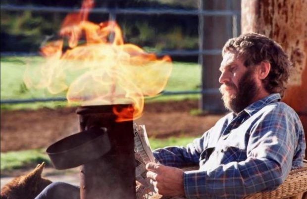 Steve McQueen having coffee, reading a newspaper, and enjoying an open fire in a lit smudge pot in the backyard of his Santa Paula home. Barbara Minty McQueen said it was his favorite part of the day. She took this last photo of him in the late spring of 1980. (Courtesy Barbara Minty McQueen)